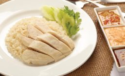 Plate of Hainanese Chicken Rice Next to Dipping Sauces
