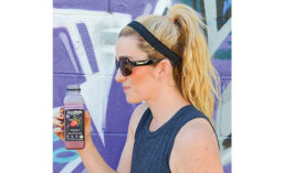 Teenage Girl Drinking Goodbelly Probiotics Beverage