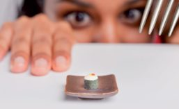 Woman Looking at Tiny Dessert