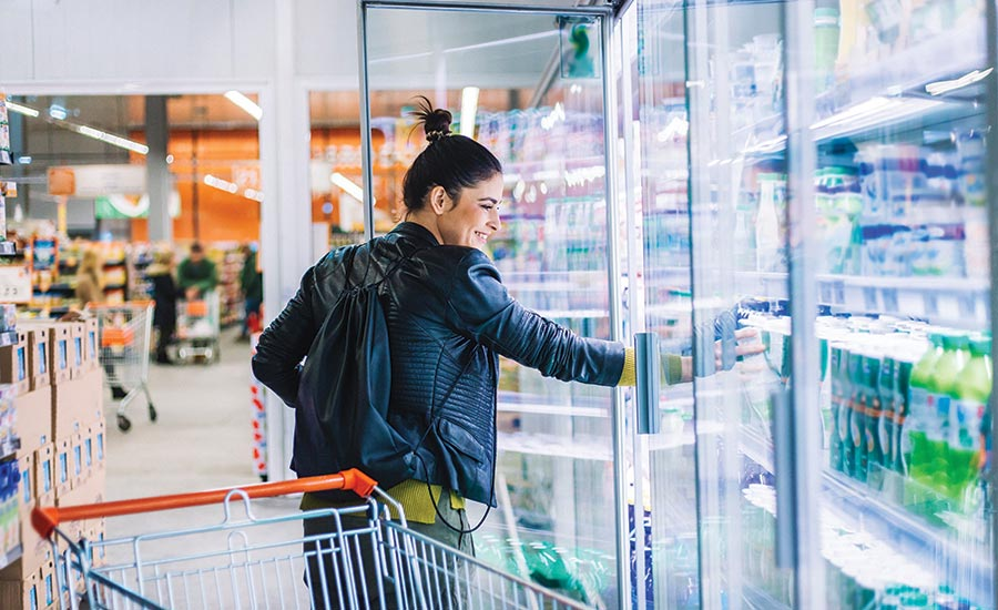 Woman Looking at Refrigerated Beverages