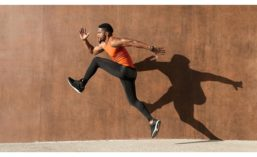 Man Running in Front of Wall