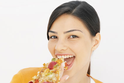Lady eating Pizza